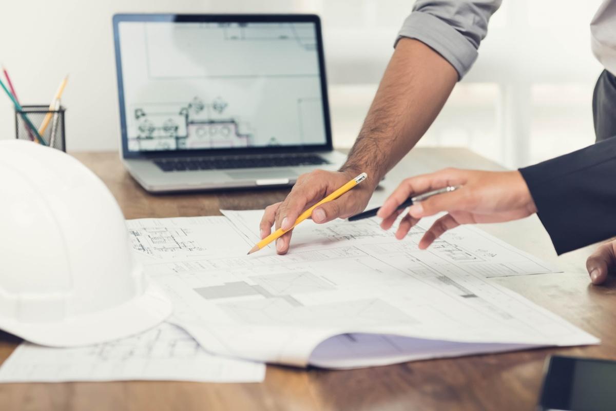 People discussing construction blueprints