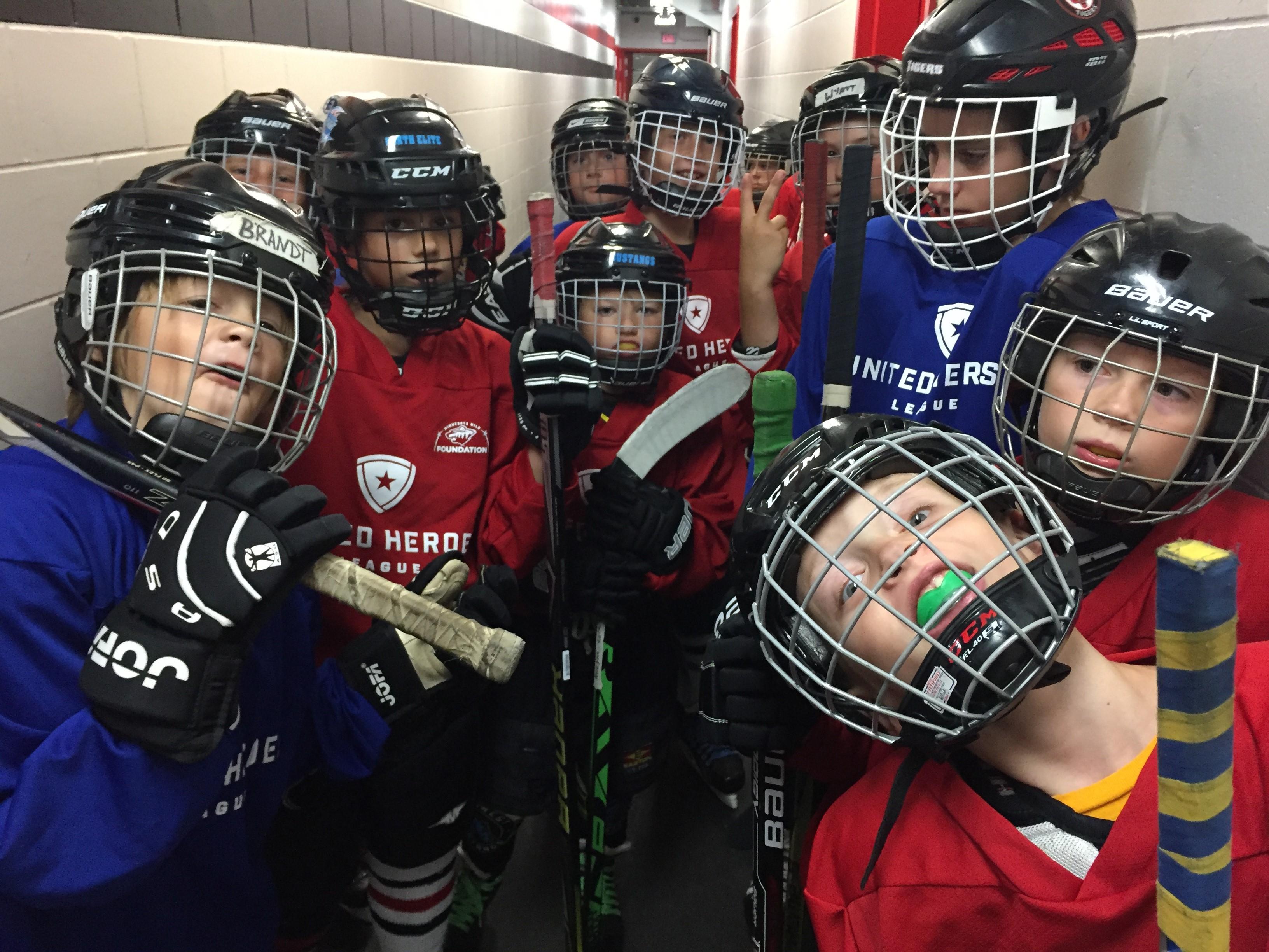 Kids in hockey gear